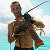 Photo of diver with a spiny lobster.