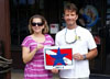 Photo of sanctuary staff handing Blue Star boat decal to Sea Dwellers own
