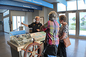 Volunteer John Bollinger provides information to visitors at the Florida Keys Eco-Discovery Center