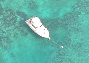 aerial view of a boat tied to a mooring buoy